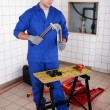 Stock Photo: Plumber bending copper pipe