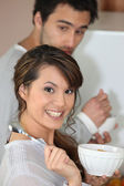 Couple eating breakfast cereal — Stock Photo