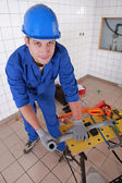 Plumber measuring plastic piping — Stock Photo