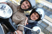 Couple riding a motor bike — Stock Photo