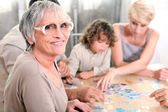 Family playing a game together — Stock Photo