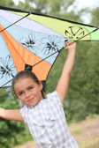 Little girl playing with a kite — Stock Photo