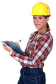 Female supervisor holding clipboard — Stock Photo