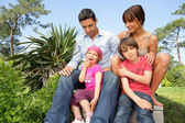 Family gathered in the garden — Stock Photo