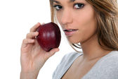 Portrait of a woman with apple — Stock Photo