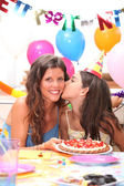Mother and daughter at a birthdayparty — Stock Photo