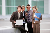 Business team stood outside office block — Stock Photo