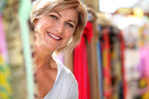 Mature lady at market — Stock Photo