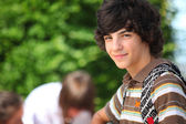 Teenage boy in the schoolyard — Stock Photo