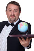 Elegant man with globe on a tray — Stock Photo