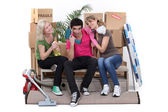 Trio of flatmates moving in together — Stock Photo