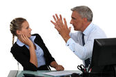 Boss shouting at assistant — Stock Photo