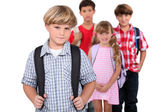 Four schoolchildren with backpacks — Stock Photo