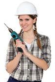 Elinde bir güç aracı tradeswoman — Stockfoto