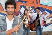 Band next to grafitti wall — Stock Photo