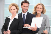Trio of dynamic businesspeople — Stock Photo