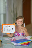 Young girl studying during the summer holidays — Stock Photo