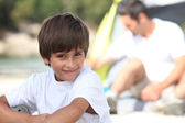 Young boy on a camping trip with his father — Stock Photo