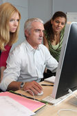 Teacher and students working together — Stock Photo