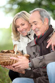 Mature couple after ramble in the woods — Stock Photo