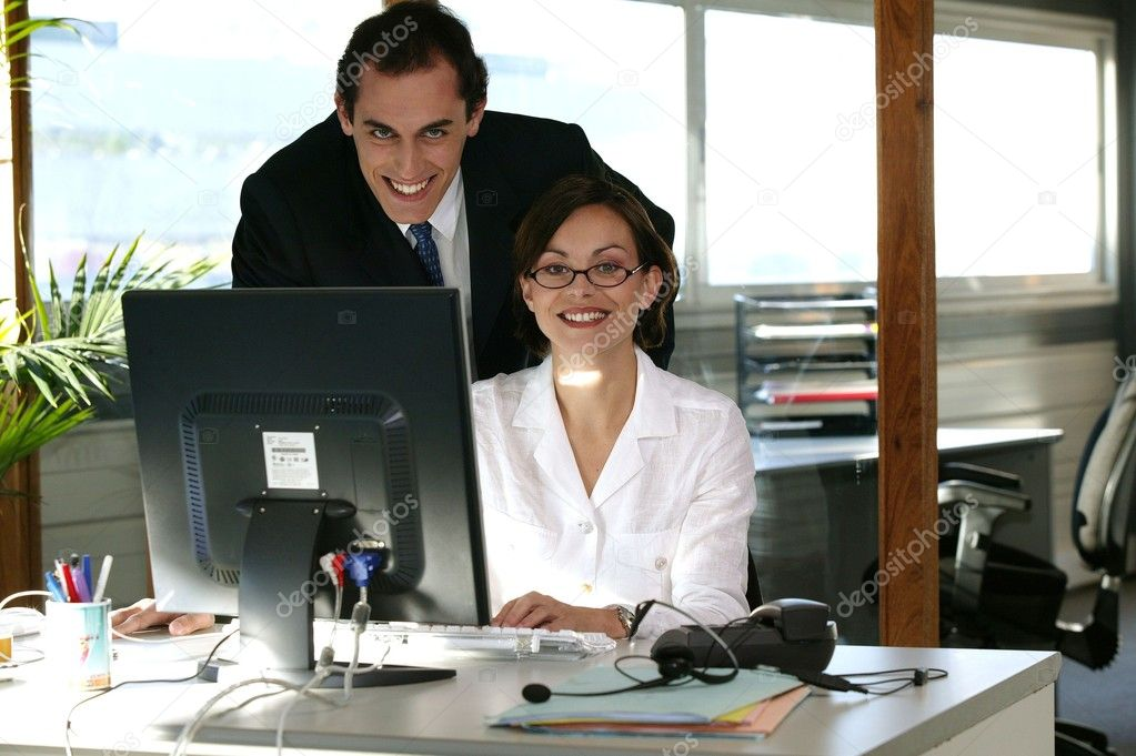 Business duo working in front of a computer  Stock Photo #9168781