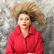 Woman with red coat lying on the floor — Stock Photo