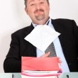Man dining on a pile of files — Stock Photo