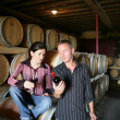 Stock Photo: Winemakers drinking wine in winery