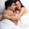 Couple sleeping together in bed — Stock Photo