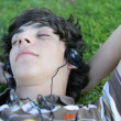 Young man listening to music — Stock Photo #9170684