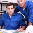 Stock Photo: Two warehouse workers taking inventory