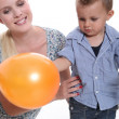 Woman and child with a balloon — Stock Photo
