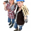 Female bricklaying team - Stock Photo