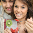 Couple eating fruit salad — Stock Photo