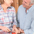 Foto Stock: Mature couple preparing vegetables