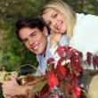 Stock Photo: Couple picking mushrooms