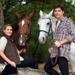 Stock Photo: Young couple with two horses