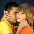 Stock Photo: Mkissing girlfriend in neck