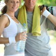 Woman and man in sports clothes — Stock Photo #9171872