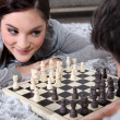 Couple playing chess — Stock Photo #9172220