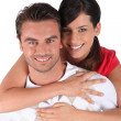Wrapping arms around boyfriend — Stock Photo #9172356
