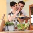 Young couple in a kitchen with a cookbook — Stock Photo #9172449