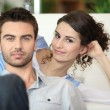 Stock Photo: Couple on sofa