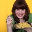 Woman eating tagliatelle — Stock Photo #9172703