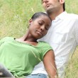 Couple relaxing in the park - Stock fotografie