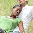 Couple relaxing in the park - Stock Photo