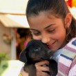 Royalty-Free Stock Photo: Young girl hugging a puppy