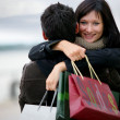 Stock Photo: Couple with shopping bags hugging
