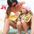 Mother and daughter at the beach — Stock Photo #9172890