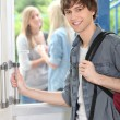 Stock Photo: Teenage boy leaving high school